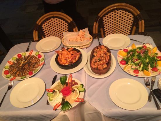 Karadeniz Dolphin: Mixed meze, salad, hamsi, jumbo prawns, and shrimp mushroom casserole