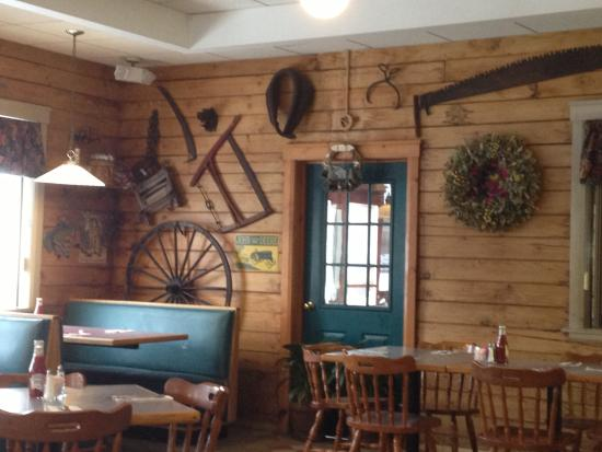 Log Cabin Family Restaurant: Log Cabin - nice antique display on wall