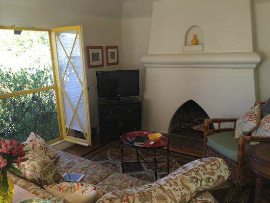 Manzanita Cottages: Yellow Cottage living room and view of garden greenery.