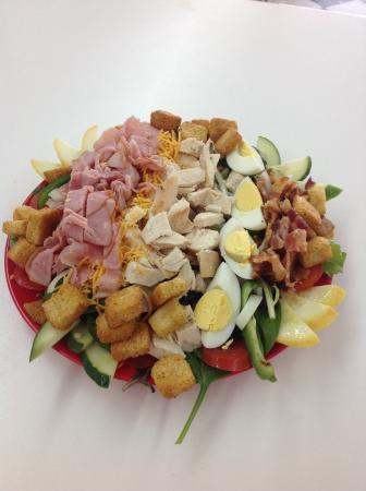 Payne's Sandwich Shop and Soda Fountain: Our Cobb salad comes with grilled chicken, bacon, ham, hard boiled eggs, cheese and every type o
