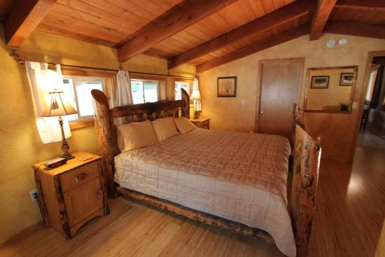 Three Rivers, CA: Falcon Chalet's master bedroom with hand peeled Lodgepole pine bed
