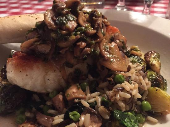 Panora, IA: Chilean sea bass with a Marsala reduction, mushrooms, onion, roasted brussel sprouts and rice. F