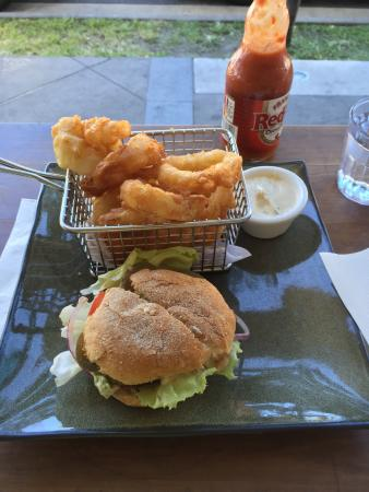 """Burger Lounge: Delicious """"Ring of Fire"""" burger (in the small size) with a side of onion rings. Franks Hot Sauce"""