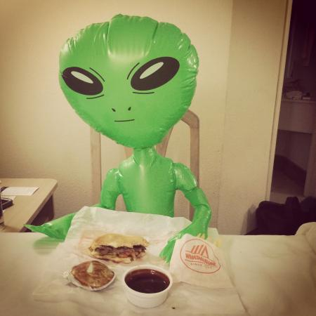 Azreal the Alien enjoying Whataburger for the first time!
