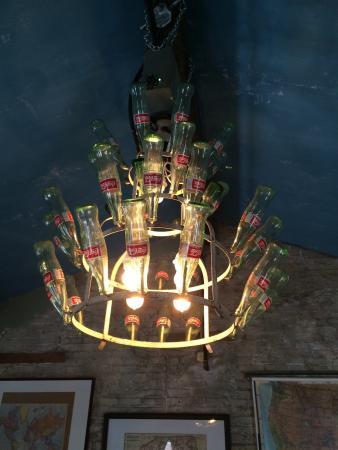 Fork & Wrench: Cool Coke Bottle chandelier.