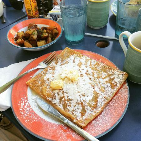 Pineapple cocnut crepe with honey and a side of hash browns. So good.