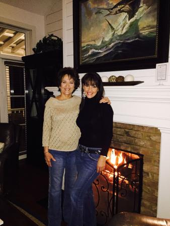 The Cottages on Charleston Harbor: My mom and I in front of the fireplace in our beautiful cottage
