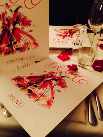 Bel Canto Restaurant: Menu and rose petals on table