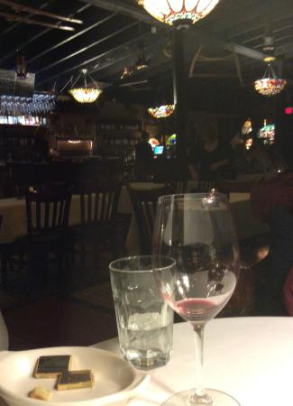 The Nova Restaurant & Wine Bar: Waitress in background setting tables for tomorrow while today lingers...