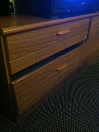 Super 8 Chambersburg/Scotland Area : Dresser in room 223. Drawers are off track, this one appears broken.