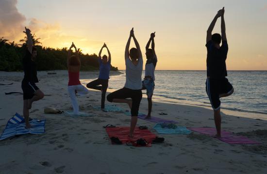 Kuri Inn: Sunrise yoga on the beach, Omadhoo