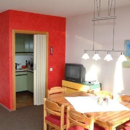 The kitchen and the dining room in the apartment 'Abendrot', the little one.