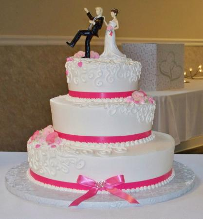 Cute Wedding Cake With Hot Pink Ribbon And Icing Flowers Picture