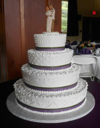 Cakes For All Occasions Beautiful 4 Tier Wedding Cake Featuring Mixed Designs And Double Ribbons