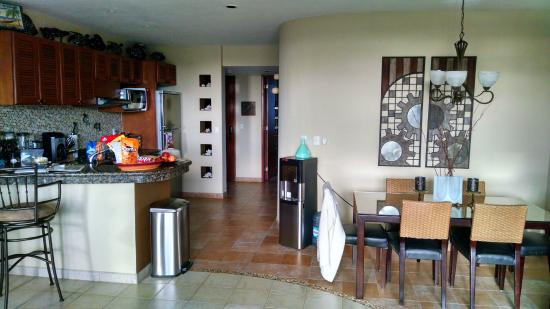 Residencias Reef Condos Kitchen Dining Area Front Door Far Back Bedroom