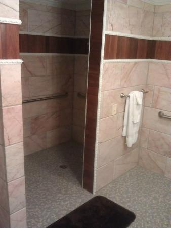 His and hers tub and shower Picture of Dover Garden Suites
