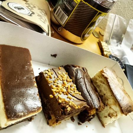 Kurtosh Cafe : Tray of amazing slices. Baked cheesecake, Röcher slice, peanut butter and chocolate slice, Blond
