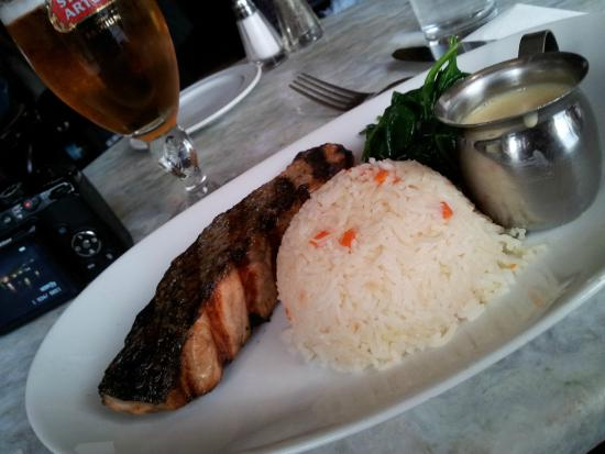 L'Express : Grilled Salmon with a side of spinach and white rice