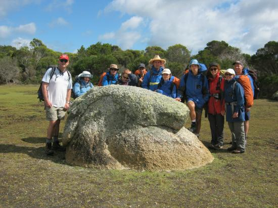 Bay of Fires Lodge: Our group surrounding an ancient rock formation