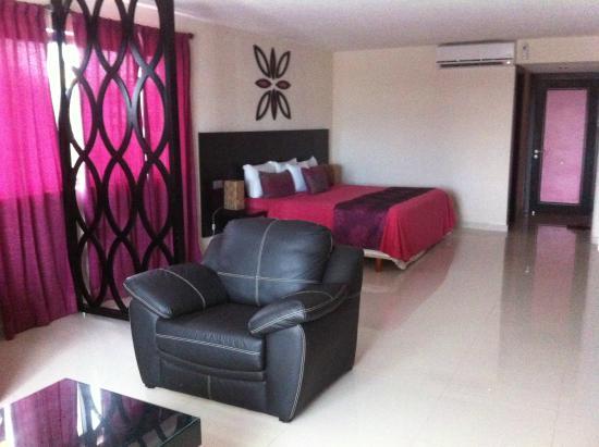 Suites Corazon : Living Area - Bed