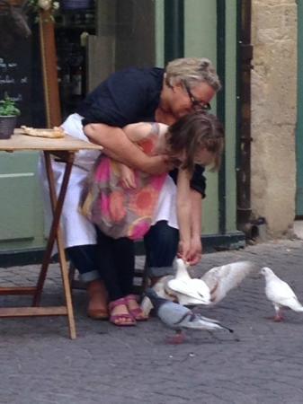 L'Epicerie de Cecile: Madame Cecile feeding pigeons