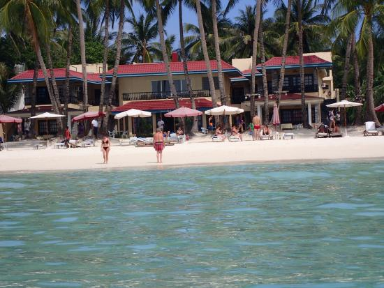 Crystal Sand Beach Resort: View of hotel from the water