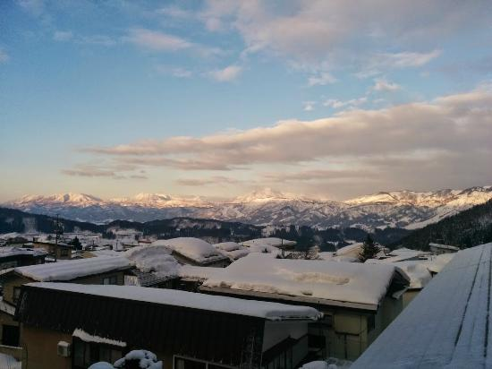 Nozawa-onsen Utopia: Morning view over the town and mountains from our lvl 3 room