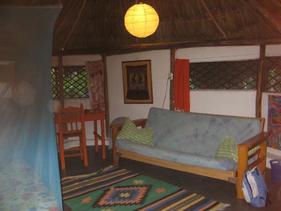 Aerolito Tulum: Casa Alux interior.  Bed, desk, shelf, and futon.