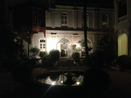Divan's Bungalow: Nighttime view of the same part of the property
