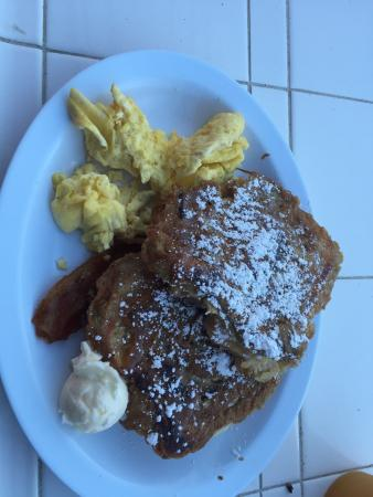Cinnamon bun French toast with eggs and bacon.