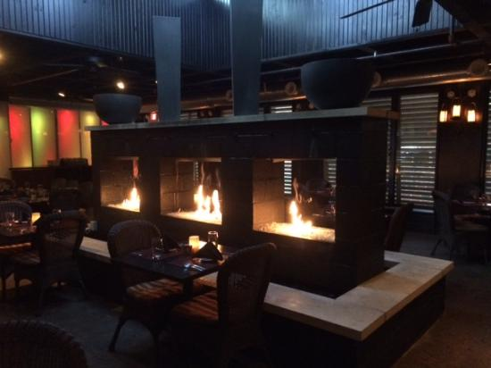triple fireplace in back bar/dining area - Picture of Marketplace ...