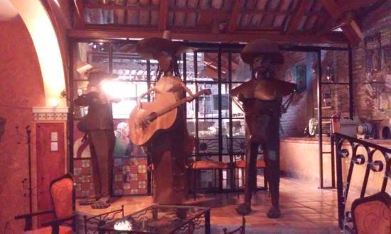 El Jardin de Ninette : Art in the dining room (bar behind it) - romantic in evening