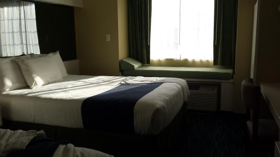 "Microtel Inn & Suites by Wyndham Gulf Shores: Two queen beds and you can see a extra ""bed"" beside/front the window"