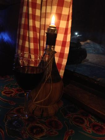 The Italian Farmhouse Restaurant: Chianti bottle candle holders on all tables