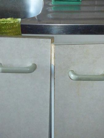 Craig Highland Farm: kitchen cupboard doors out of alignment - don't close properly