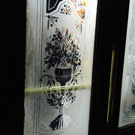 Fanelli Cafe: Etched glass on the front door.