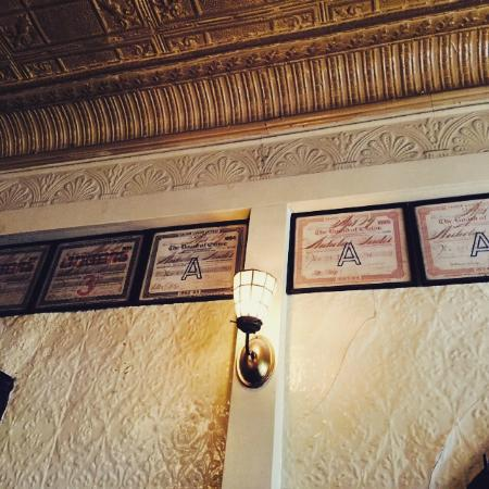 Fanelli Cafe: The back room wall had ale house certificates dating back to 1899.