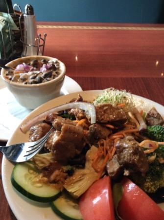 Ethos Vegan Kitchen: black bean soup and grilled seitan over a mixed veggie salad.