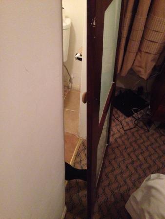 Cat flap bathroom door picture of the strand hotel for Cat bathroom door
