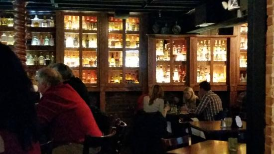 The Miller House Restaurant : Downstairs bar with wall of bourbons