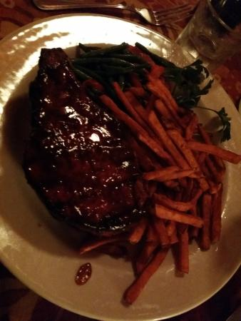 McPhee's Grill: Thick pork chop with sweet potato fries