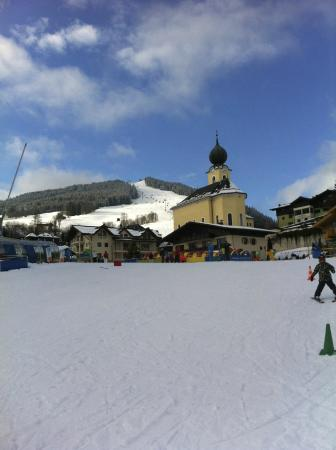 Hotel Post: Looking up to the Hotel,  and Church,  from the Ski School