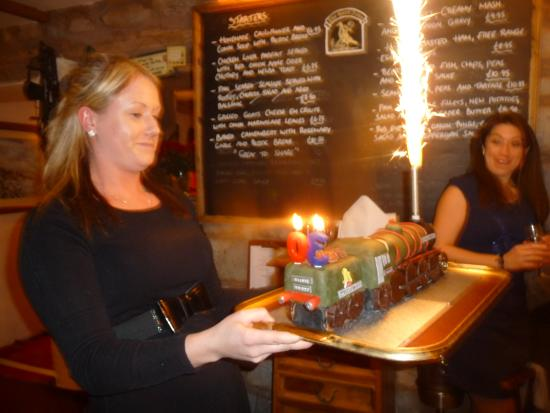 The Hood Arms: Jasmine brings in the amazing cake.