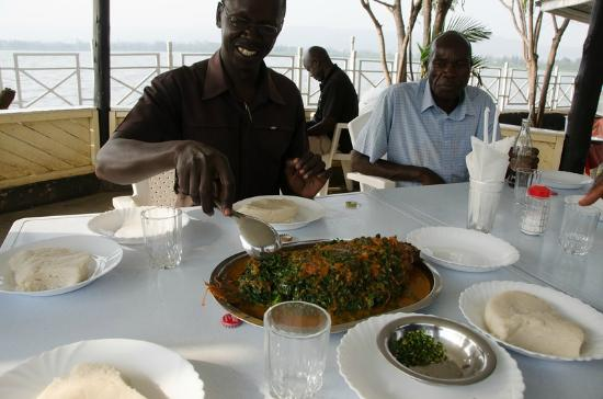 Tilapia Beach: Tilapia in the middle, and four servings of ugali. Note the lack of utensils--use your hands!