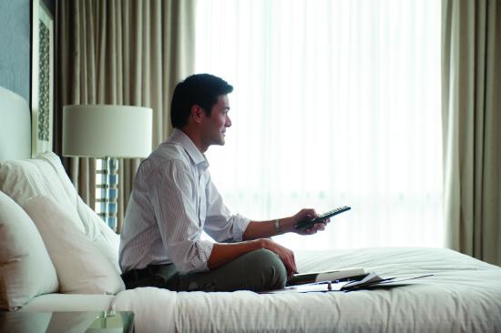 Hilton Garden Inn Riyadh Olaya: Business Man on bed