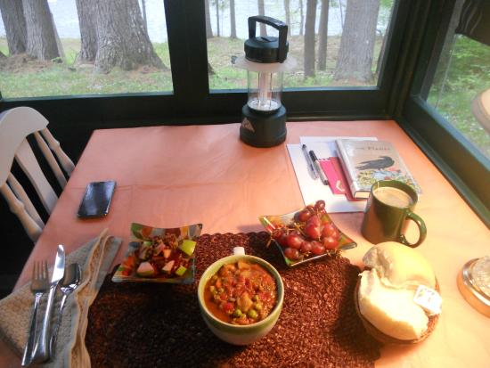 The Cabins In Hope: A warm dinner on the screened-in porch after a day of hiking