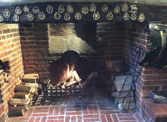 The Running Horses: Fireplace main bar area