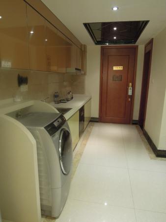 pantry + washing machine - Picture of Sunshine Apartment, Guangzhou ...