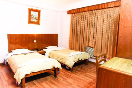 Tasi Dhargey Inn : twin bed room