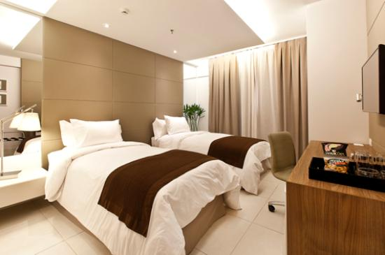 Quarto Luxo Twin 2 camas de solteiro Foto de Hilton